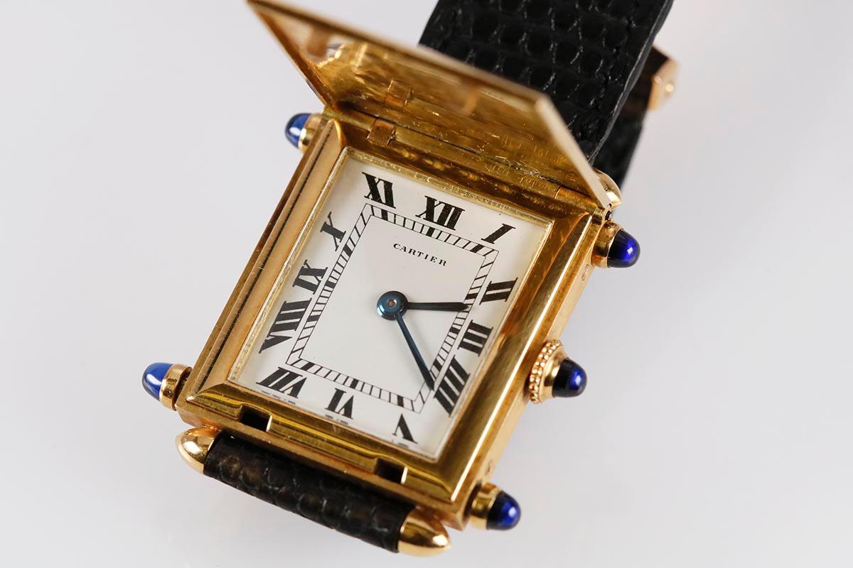 Cartier Tank Obus Savonnette open yellow gold with five blue sapphire cabochons for A Collected Man Lodnon