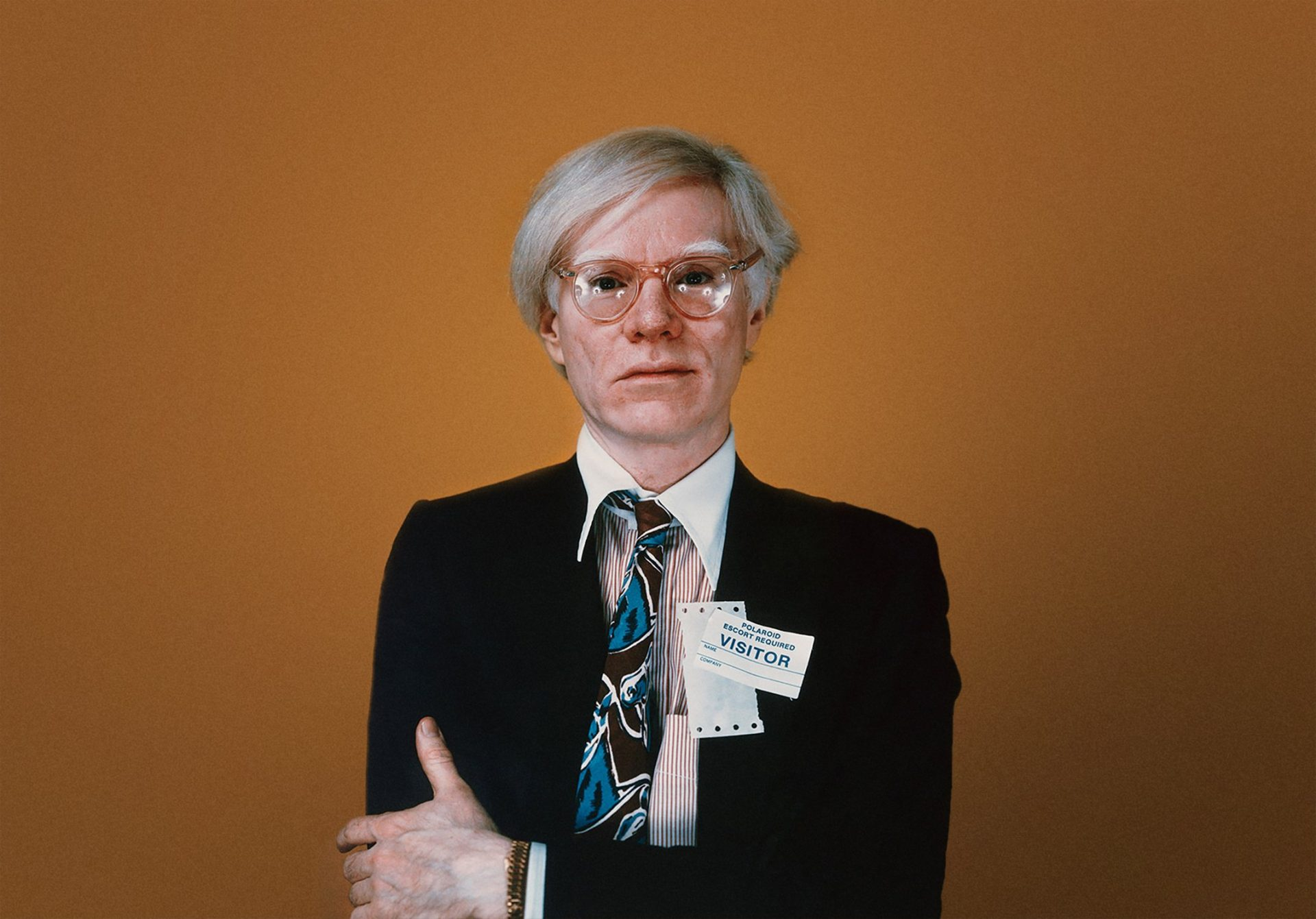 Warhol wearing a gold Rolex in Understanding Andy Warhol as a collector for A Collected Man