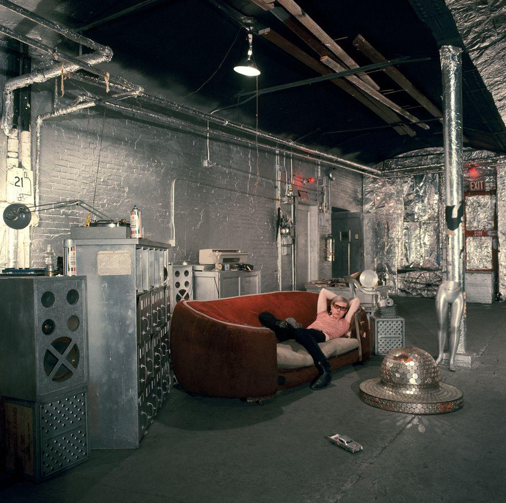 Warhol on the famous red sofa in silverlined room in the Factory in Understanding Andy Warhol as a collector for A Collected Man