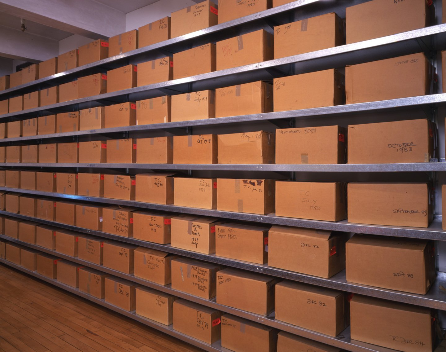 Wall of boxes containing Andy Warhol time capsules in Understanding Andy Warhol as a collector for A Collected Man